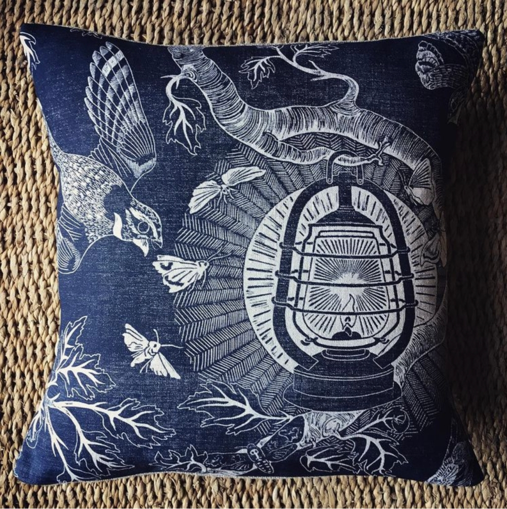 Blue cushion with lantern depiction